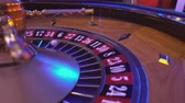 gamble : Roulette Wheel in a casino - ball on field 6 black Stock Footage