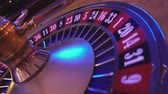 gamble : Turning Roulette Wheel in a casino - perspective view