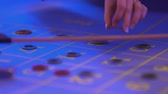 pôquer : Roulette table in a casino - putting gaming chips on table