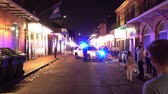 culto : New Orleans Police blocking street in the French Quarter at night