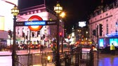 английский : London Underground station at Piccadilly Circus - time lapse shot at night Стоковые видеозаписи