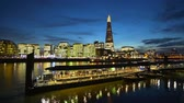 английский : London skyline with Shard and Tower Pier at night - time lapse shot Стоковые видеозаписи