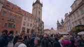 Československo : Tourists at the Old Town Square in Prague watching the astronomical clock