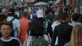 holandia : Huge crowd of people walk on the sideways of Damrak street in Amsterdam - Slow Motion - AMSTERDAM  HOLLAND - JULY 21, 2017