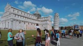 toscana : Tourists take photos of the Leaning Tower in Pisa and the Cathedral - PISA TUSCANY ITALY - SEPTEMBER 13, 2017