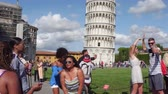 italiano : Tourists take photos and selfies at the leaning Pisa Tower on Miracoli Square - PISA  TUSCANY ITALY - SEPTEMBER 12, 2017