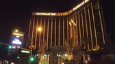 casino chips : Mandaly Bay Hotel and Casino in Las Vegas at night - view from Las Vegas Boulevard - USA 2017