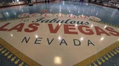 poker : Welcome to Las Vegas sign on the floor of McCarran International Airport - USA 2017