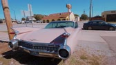 fence : Classic American Oldtimer Car like Pink Cadillac at Route 66 - USA 2017