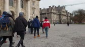 river liffey : People visiting the famous Trinity College in Dublin