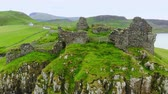 nagy britannia : The ruins of Duntulm Castle on the Isle of Skye - aerial drone footage