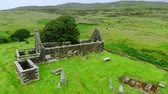 nagy britannia : Ruins of an old church and cemetery in Scotland - aerial drone footage