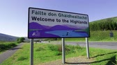 geology : Welcome to the Highlands sign in Scotland Stock Footage