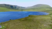 çayır : Beautiful blue lakes in the Highlands of Scotland - aerial drone flight Stok Video