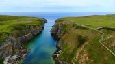 britânico : Flight over Smoo Cave in the Highlands of Scotland near Durness