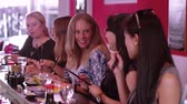 авокадо : Group of women having fun in a Sushi restaurant