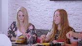 essstäbchen : Two young women in a Sushi restaurant Stock Footage