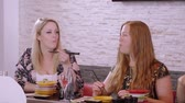 авокадо : Two beautiful girls eat Sushi at a bar