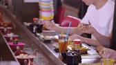 にぎり : Eaiting freshly made Sushi at a Running Sushi Bar 動画素材