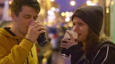 saúde : Two friends with a glass of beer in their hands say cheers Stock Footage