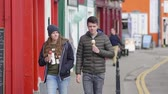 kerry : Young couple walks down the streets and eats ice cream
