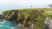 wave : Amazing flight over the rough coast of Dunquin Pier in Ireland Stock Footage