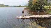 kerry : Flight around a young woman standing on a pier