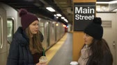 urbane : Two women on a New York subway station waiting for their train