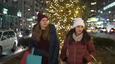urbane : Two girls shop Christmas presents in New York
