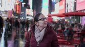urbane : Young woman at New York Times by night
