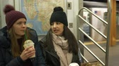 urbane : Two girls sit in a New York subway train Stock Footage
