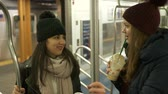 urbane : Two girls riding the New York subway