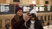 urbane : Young women visit New York Grand Central Station