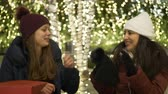 urbane : Two girls in New York at Christmas time enjoy shopping presents Stock Footage