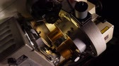 кино : Close up of a 35mm cinema projector in a movie theater