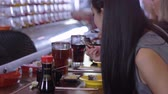 にぎり : People eating Sushi in a Running Sushi restaurant 動画素材