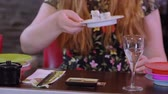 にぎり : People in a Running Sushi restaurant enjoy Asian food from the bar