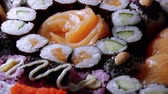 выбор : Selection of freshly made Sushi pieces on a plate