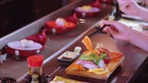 にぎり : Eating fresh Sushi in an Asian restaurant