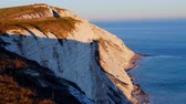 erodált : Sunset over the White Cliffs at Beachy Head in Sussex England Stock mozgókép