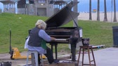 Piano player at Venice Beach oceanfront - CALIFORNIA, USA - MARCH 18, 2019