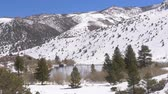 eastern sierra : Beautiful pond in the snow covered mountains in the Sierra Nevada