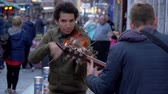 egy sorban : Street musicians in the city of Galway Ireland - GALWAY, IRELAND - MAY 11, 2019