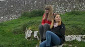 castello : Two young woman relax in the green landscape of Ireland