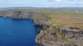 castello : Cliffs of Moher in Ireland at the Atlantic Ocean - aerial drone footage