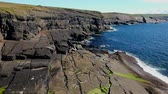 eroze : Cliffs of Kilkee in Ireland aerial view Dostupné videozáznamy