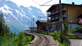 Train station of Murren located on a mountain in the Swiss Alps - SWISS ALPS, SWITZERLAND - JULY 20, 2019 Filmati Stock