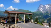 スイス : Train station of Murren located on a mountain in the Swiss Alps - SWISS ALPS, SWITZERLAND - JULY 20, 2019 動画素材