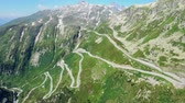festői : Amazing Grimsel Pass in the Swiss Alps aerial view - Switzerland from above Stock mozgókép