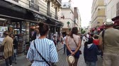 예망 : French girl walks at Montmartre hill in the city of Paris - PARIS, FRANCE - JULY 29, 2019